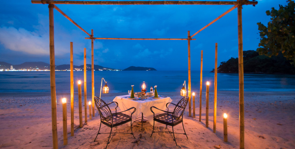 Romantic dinner on the beach for two.