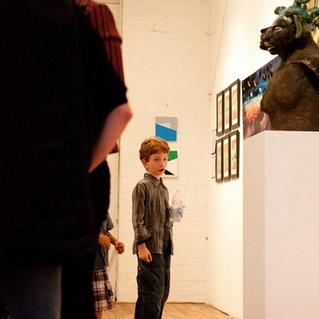 YOUNG ART PATRON VIEWING ARTIST DANIELLE