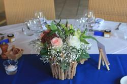 Centre de table avec bois flotté à l'hôtel Punta Lara