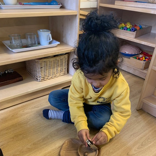 Nutmeg grating helping develop fine motor skills ready for pencil grip and writing.