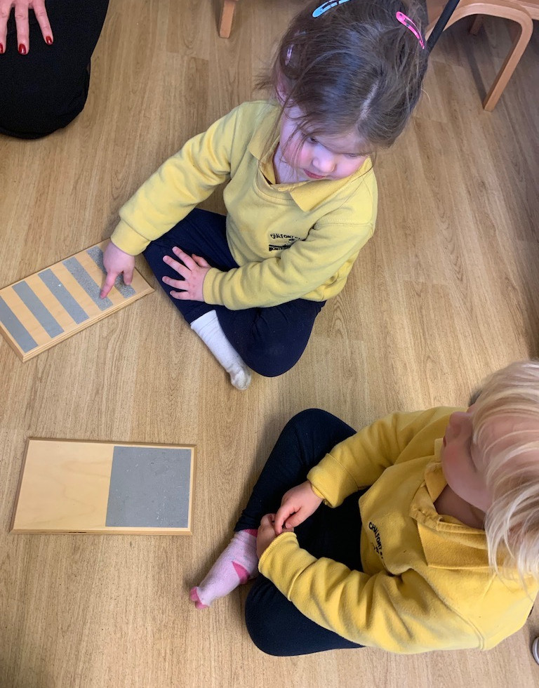 Rough and smooth boards are to refine the skills of touch in preparation for sandpaper letters and numbers.