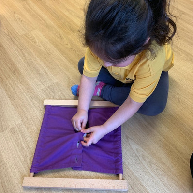 In preparation for independant dressing, dressing frames allow the children to experience practical activites such as buttoning whilst developing their fine motor skills.