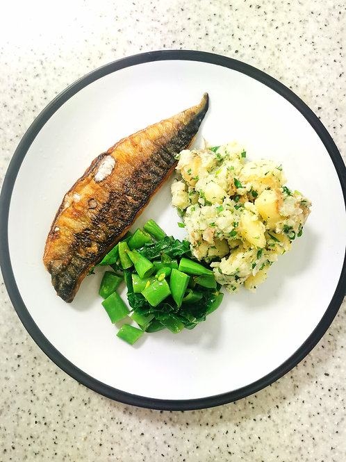 Mackerel with crushed news and wilted greens