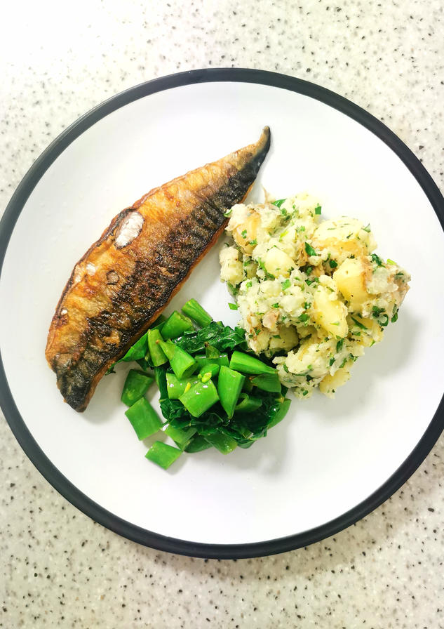 Mackerel with crushed new potatoes and spring greens