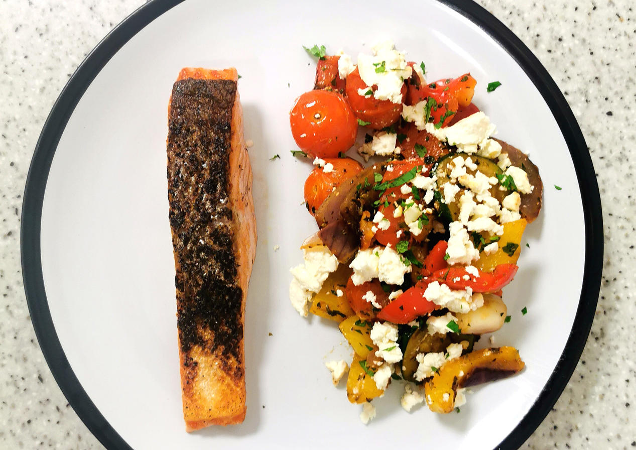 Pan fried salmon with greek style vegetables