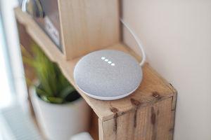 round-grey-speaker-on-brown-board-107285