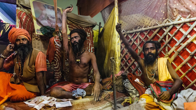 Naga Baba demonstrate their votes on the night of Maha Kumbh Mela in Allahabad in 2013