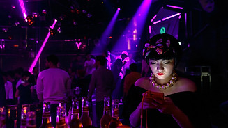Feng Qian chat in a nightclub on the top floor of a skyscraper