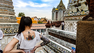 A girl at the temple complex of Wat Arun