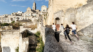 Boys run in the streets of Matera