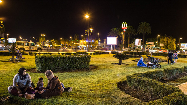 Moroccans in the parks along Hassan II Avenue in Fez