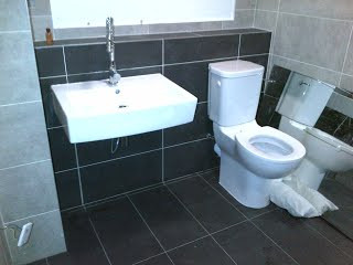 Bathroom plumbing in central London, before;