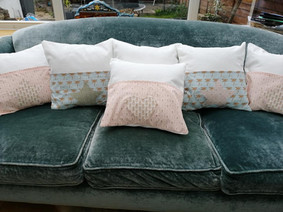 Applique cushions with front pocket detail
