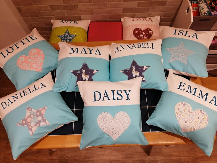 Personalised applique cushions with a front pocket