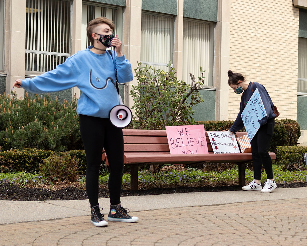 Seniors Savannah Karcz (let) and Bekira Rabinowitz (right) protest Canisius' response to the sexual assault lawsuit (Mike Pesarchick/The Griffin) .