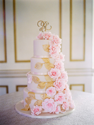 Four tier wedding cake with cascade of delicate pink sugar roses