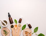 Various herbs, tinctures and essential oils; wooden spoons and discs with herbs and supplements