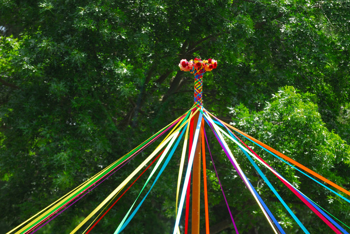 Image of a partially woven Beltane May Pole