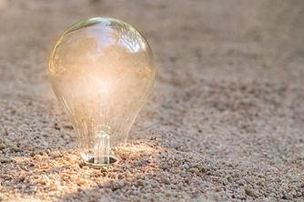 vecteezy_natural-energy-concept-of-lightbulb-on-beach_1223460.jpg