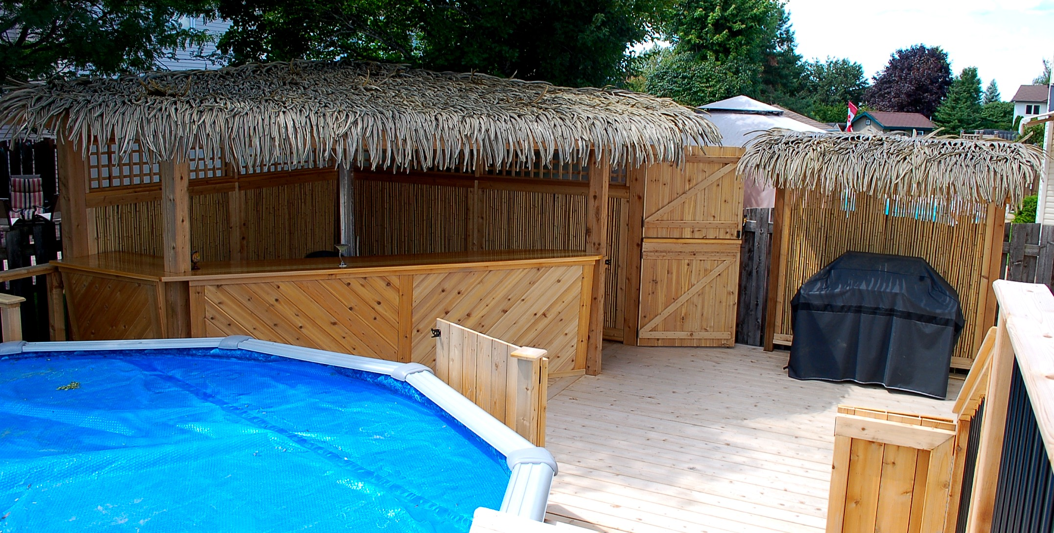 Tiki Bar and BBQ Cover and Pool Deck.