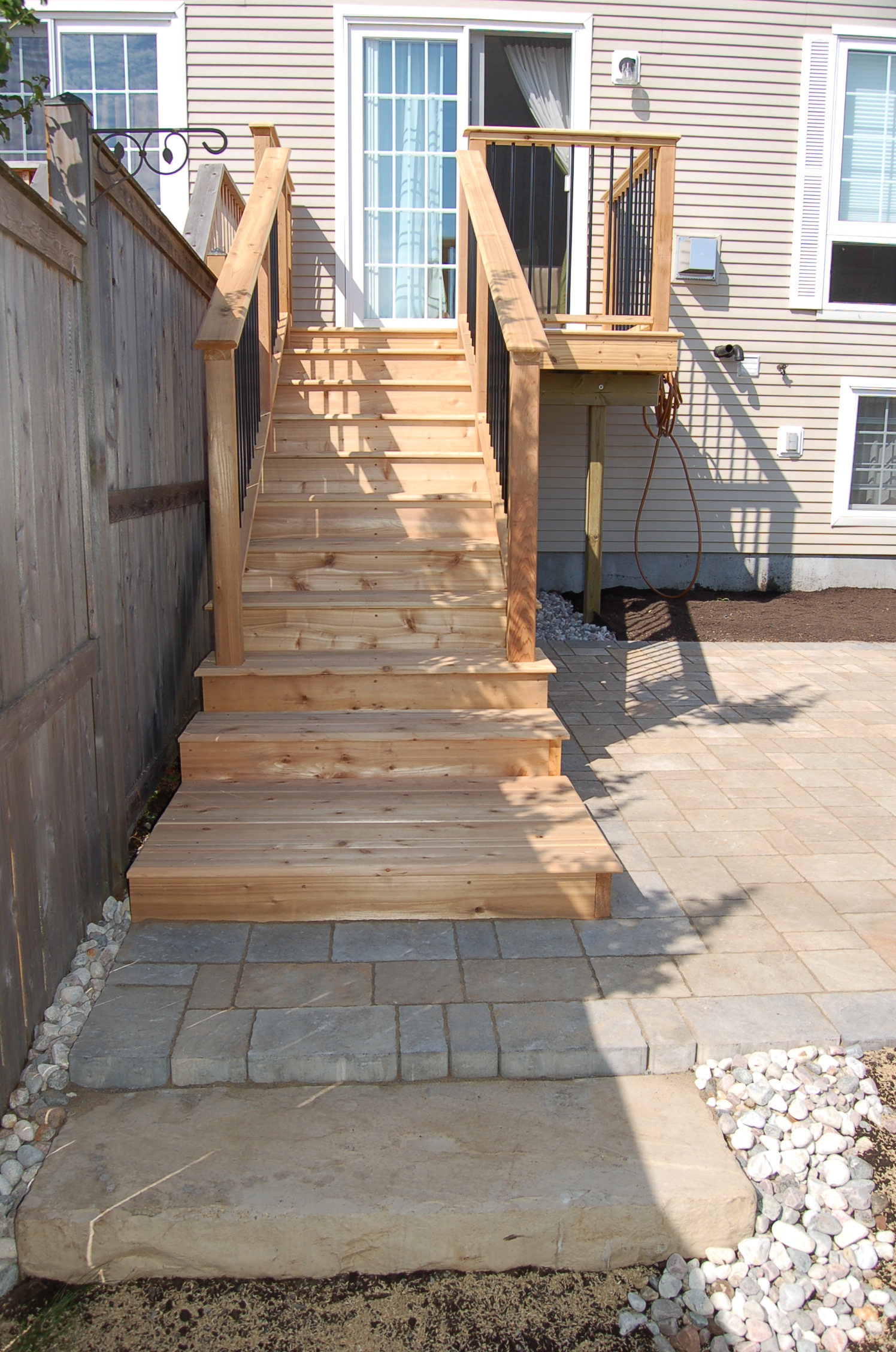 Townhouse Deck Steps and Brick Patio