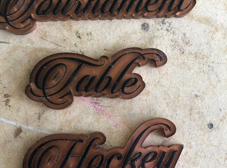 Laser cut badges for table hockey game