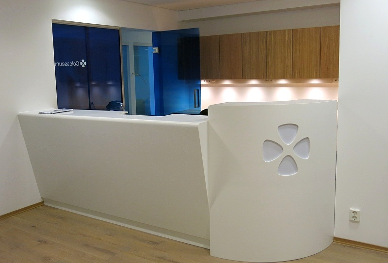 Reception desk with the clinic logo