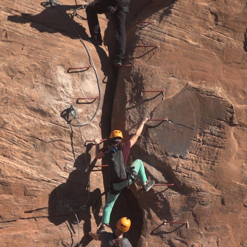people rock climbing in moab utah