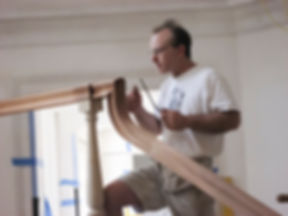 Kevin Jacson Woodworker Finishing a Staircase