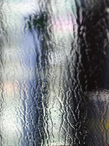 Lights through a rain soaked window