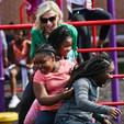 Lindsey on slide with kids - Lindsey Sea