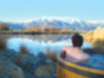 View from Hot Tubs of snowy mountains and lake