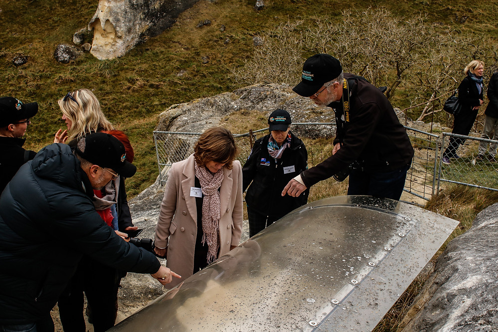 People looking at in-situ fossil of Baleen whale