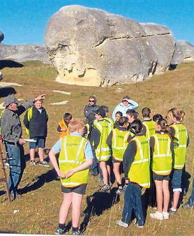 Group of kis learning about limestone of Elephant Rocks
