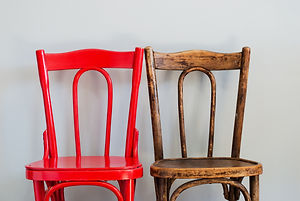 Pair of Red and Brown Chairs on a Grey W