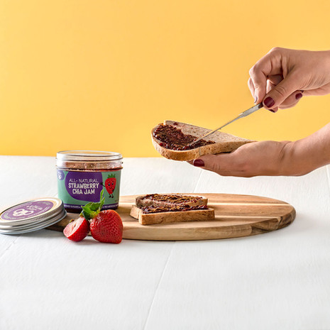 Spreading healthy jam on bread
