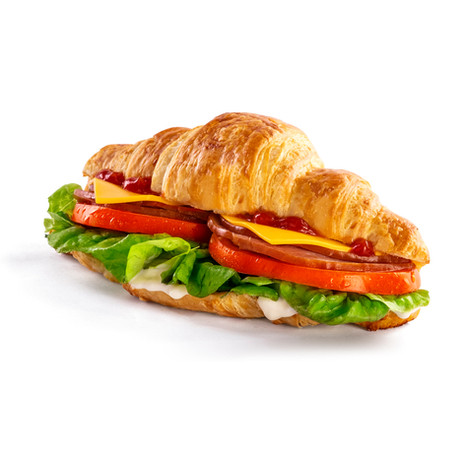 Healthy croissant with meat and salad