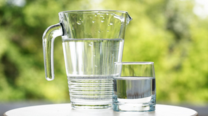 glass pitcher of water and glass of water