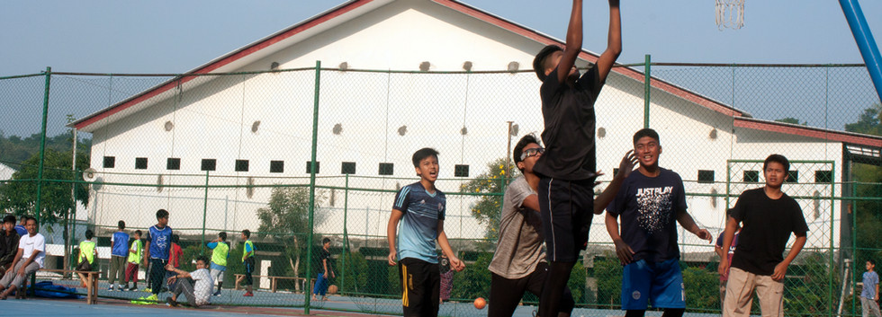 Students are playing basketball
