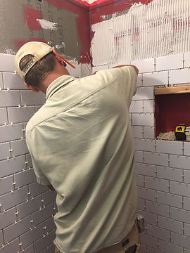 Robert Trembley installs tile on a custom shower