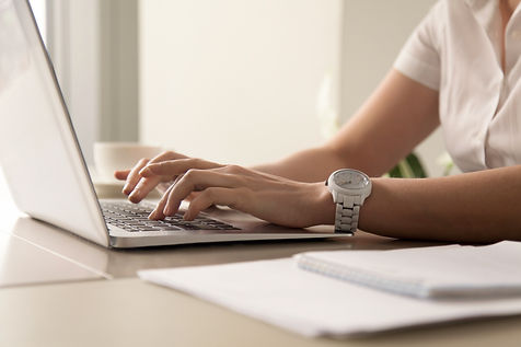 womans-hands-typing-on-laptop-at-workpla