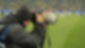 photographer-with-a-camera-with-a-large-