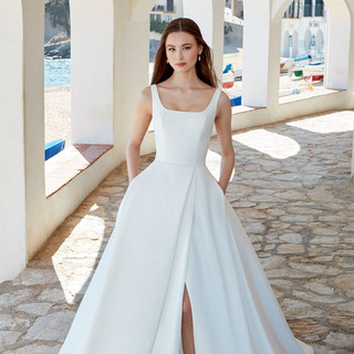 Simple wedding gowns with a slit