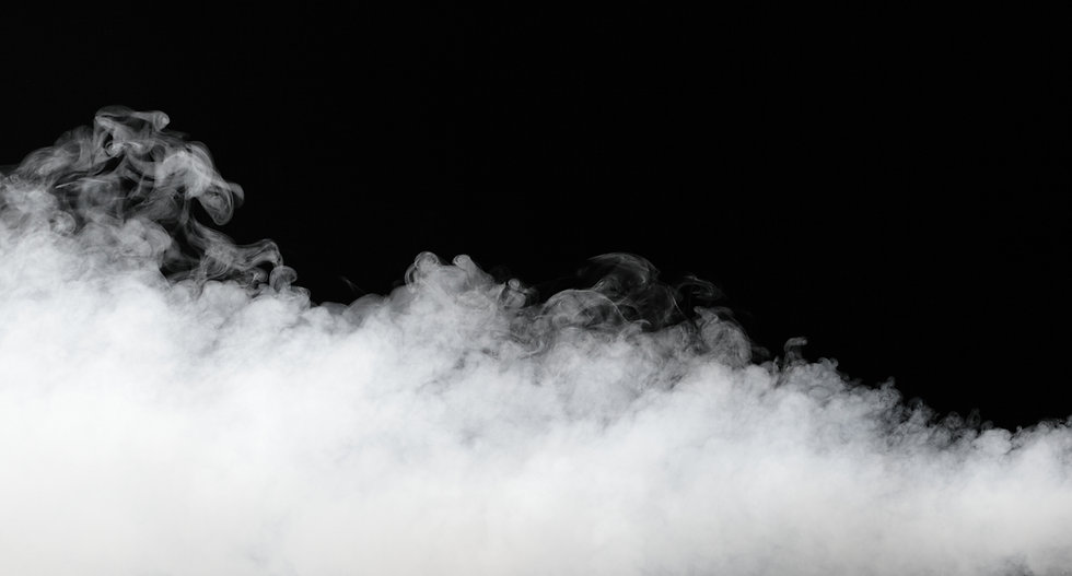 Photo of swirling steam and mist against black background.