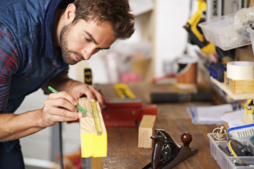a carpenter taking measurements