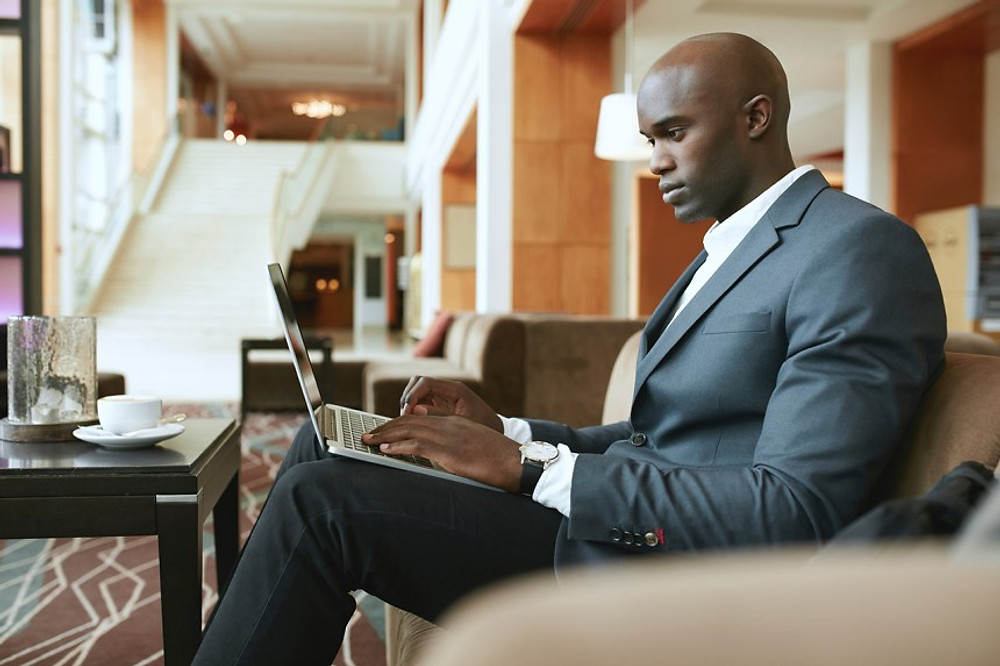 a businessman filling out a form online