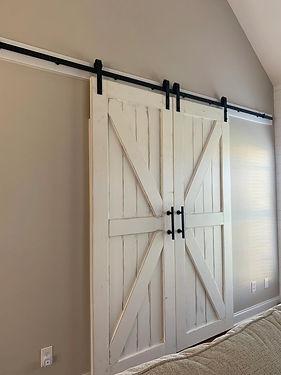 distressed, white farmhouse style barn door.jpeg