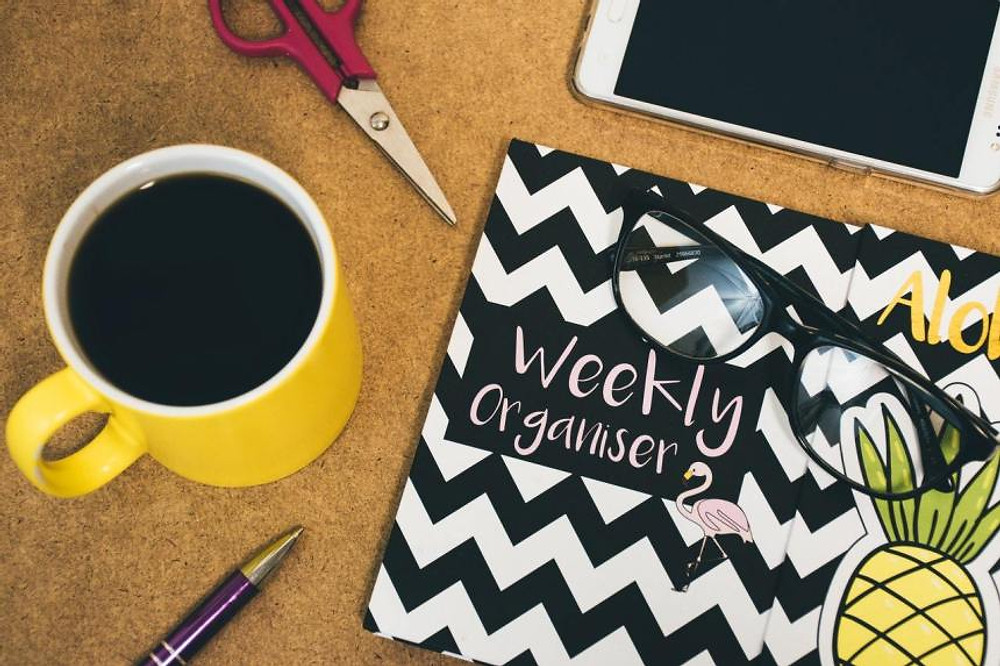 weekly planner with coffee