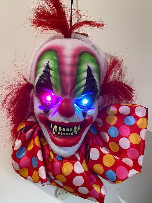 Creepy hanging clown head