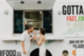 bride and groom with food truck.jpg
